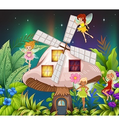 Fairies flying around the mushroom hosue at night vector