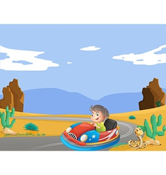 A young boy travelling at the desert vector image