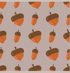 Cute seamless pattern made of brown acorns vector