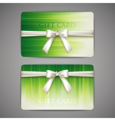 green gift cards with white bows and ribbons vector image vector image