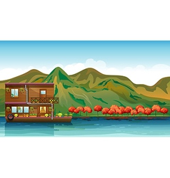 A river and a boat house vector