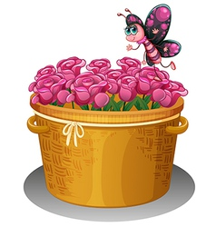 A basket of pink roses with a butterfly vector image