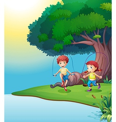 A boy and a girl playing near the giant tree vector