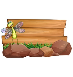 A dragonfly above the rock with an empty wooden vector