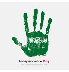 Handprint with the flag of saudi arabia in grunge vector
