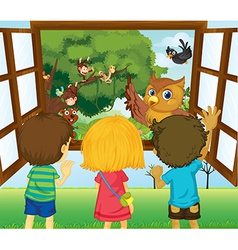 Three kids watching the different animals in the vector image