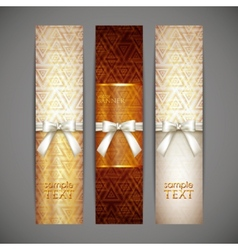 set of golden banners with white bows and ribbons vector image