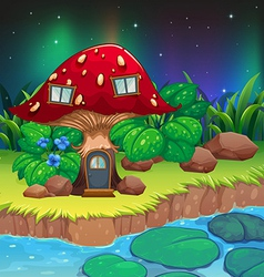A red mushroom house near the river with vector