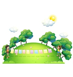 Two girls with hanging clothes at the hilltop vector image vector image
