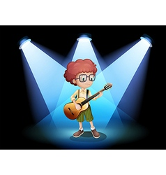 A young guitarist at the center of the stage vector