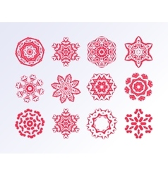 Red snowflakes on white background vector