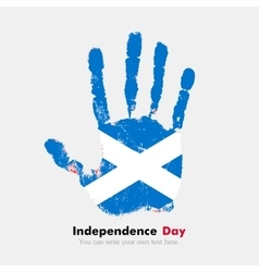 Handprint with the flag of scotland in grunge vector