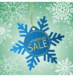 Snowflake sale tag on a snowy background vector