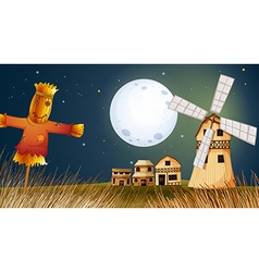 A scarecrow in the ricefield near the windmill vector image vector image