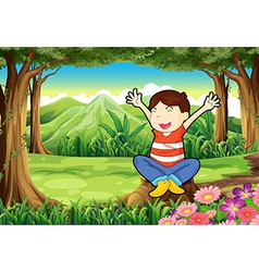 A happy kid above the stump at the jungle vector image