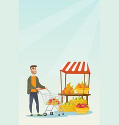 Young caucasian man pushing a supermarket cart vector