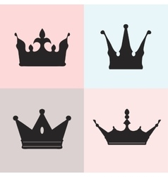 Set of four silhouettes of crowns vector