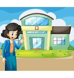 A woman in front of the hospital vector