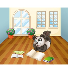 A panda reading inside the house vector