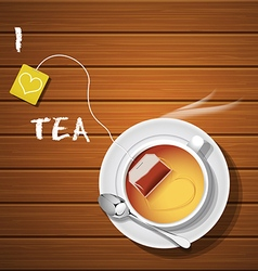 A cup of hot tea and tea bag with steam vector