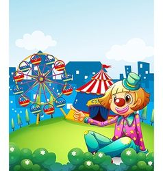 A female clown pointing the carnival vector image vector image