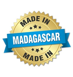 Made in madagascar gold badge with blue ribbon vector