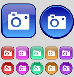 camera icon sign A set of twelve vintage buttons vector image