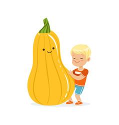 happy boy having fun with fresh smiling zucchini vector image