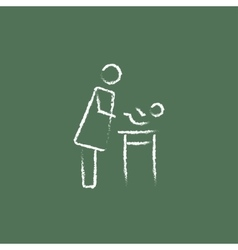 Mother taking care of the baby icon drawn in chalk vector image