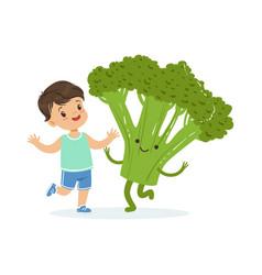 happy boy having fun with fresh smiling broccoli vector image