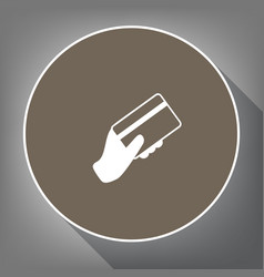 Hand holding a credit card white icon on vector