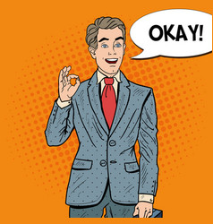 Pop art happy businessman gesturing ok vector