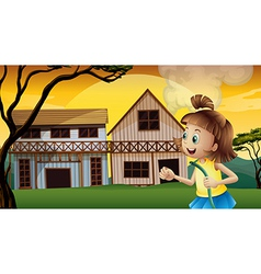 A happy young girl holding a waterhose vector image
