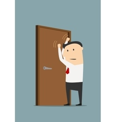 Businessman knocking on a closed door vector image