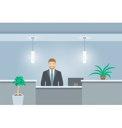 Young man receptionist stands at reception desk vector