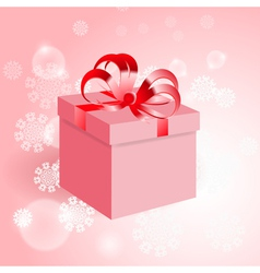 Gift with red bow on background with snowflake vector image