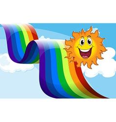 A cheerful sun near the rainbow vector image