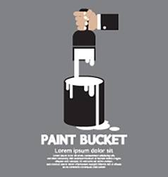 Paint bucket with paintbrush in hand vector
