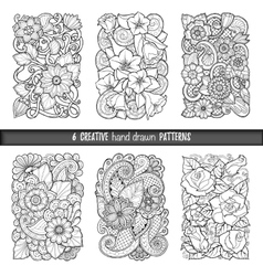Set of backgrounds in with doodles flowers vector