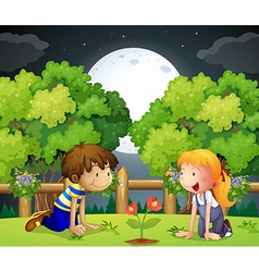 Two kids watching the growing plant vector image