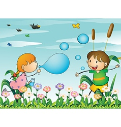 Kids at the garden playing with the blowing vector image