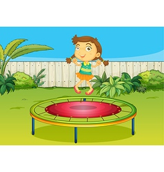 a girl playing on trampoline vector image