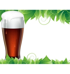 Glass of beer with green leaves vector