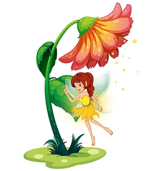A fairy under a giant flower vector image vector image