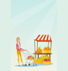 Young caucasian woman pushing a supermarket cart vector