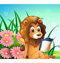 A lion reading a book at the garden vector image
