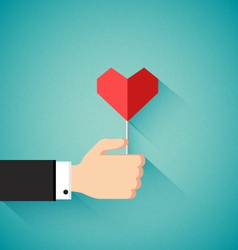 Valentines day concept with hand holding heart vector