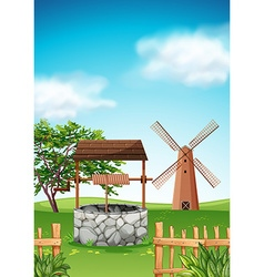 Scene with windmill and well in the farm vector