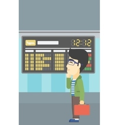 Man looking at departure board in the airport vector