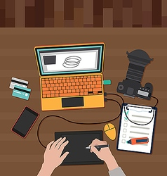 Photographer working on a laptop vector image